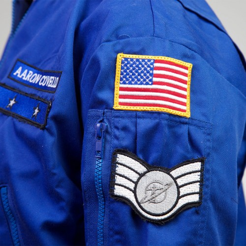 Space camp jacket that includes camper's name, camp division, nationality, and years enrolled in program
