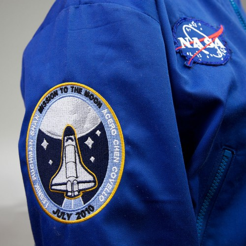Space camp jacket that includes NASA logo, and mission patch
